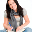 Student woman holding book - Stock Photo
