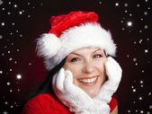 Christmas woman in santa cap — Stok fotoğraf