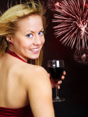 Smiling blond woman holding wine — Stock Photo