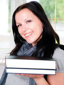 Smiling student woman holding book — Stock Photo