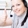 Woman with headphones in office — Stock Photo #2404419