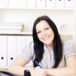 Smiling brunette woman working in office — Stock Photo #2404420