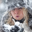 Woman Blowing Snow — Stock fotografie