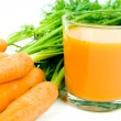 Orange carrots with juice — Stockfoto