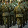 Stock Photo: Soldiers march in formation