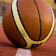 Stock Photo: Ball in sport parquet