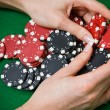 Poker player raking a big pile of chips — Stock Photo