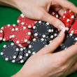 Stock Photo: Poker player raking big pile of chips