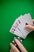 Poker cards and female hand betting — 图库照片