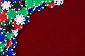 Gambling chips red background — Stock Photo