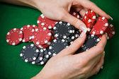 Poker player raking a big pile of chips — Stock Photo