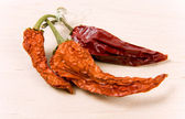 Dried-up red paprika on kitchen board — Stock Photo