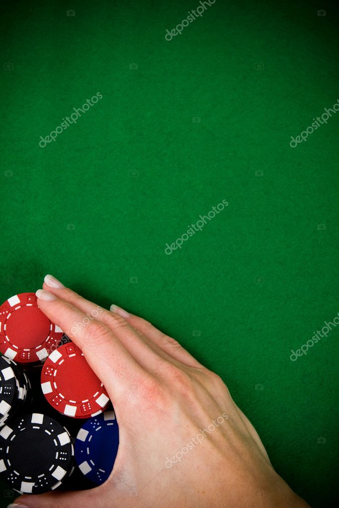 Female hand rakes up stack of poker chips — Stock Photo #1726134