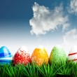 Easter eggs in green grass over blue sky with cl — Stock Photo #2612865