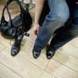 Adult woman trying on shoes in a store — Stock Photo