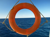 Orange safe guard ring against sea backg — Stock Photo