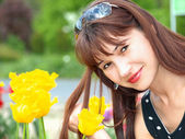 Woman in garden with tulips — Stock Photo