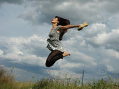 Very happy woman jumping pleasure odes — Stock Photo