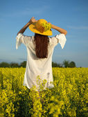 Beautiful woman on field in bloom — Stock Photo