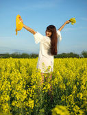 Beautiful woman on field in bloom — Stock Photo