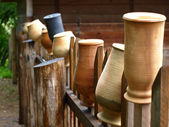 Clay jug on a fence — Stock Photo