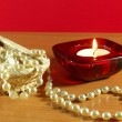 Stock Photo: Perls and candle