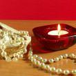 Perls and candle - Stock Photo