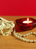 Perls and candle — Stock Photo