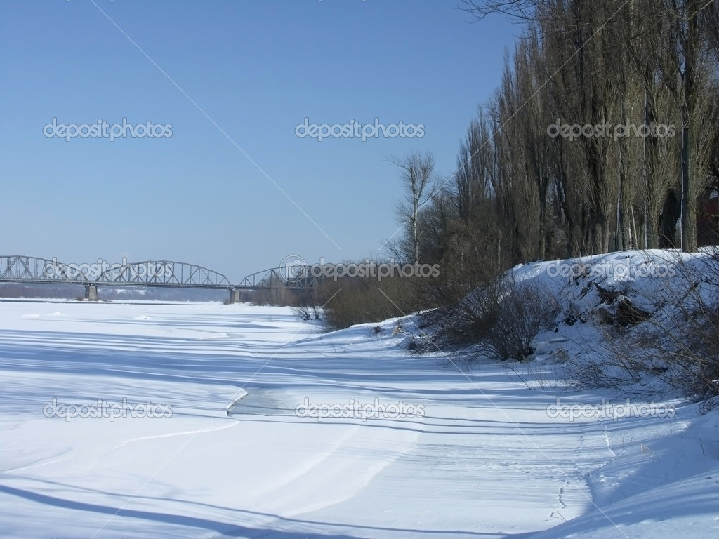 Winter landscape by the river into a sunny day — Foto de Stock   #1694644