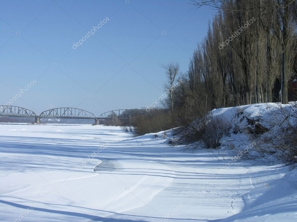 Winter landscape by the river into a sunny day — Lizenzfreies Foto #1694644