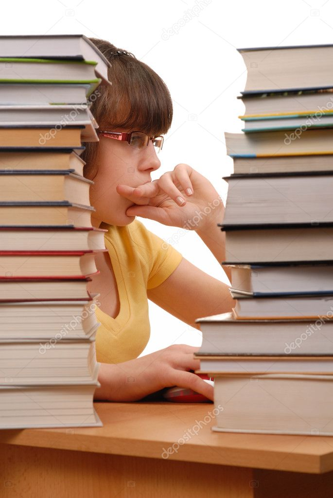 Teenage girl with her computer and books isolated on white — Stock Photo #1608783