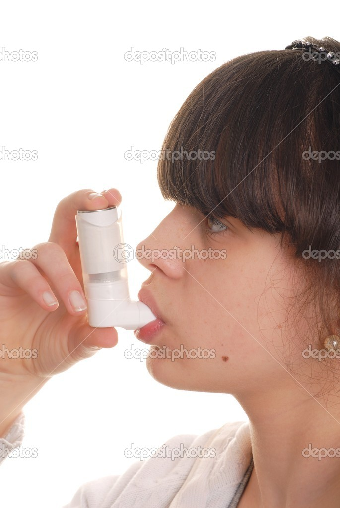 Teenage girl holding an inhaler isolated on white — Stock Photo #1760571