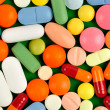 Stock Photo: Pills on Green