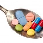 Pills on Spoon — Stock Photo