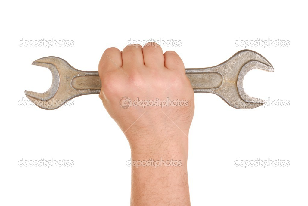 Hand holding big spanner isolated on white — Stock Photo #1970151