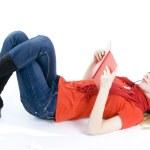 Reading girl in headphones — Stock Photo