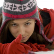 Pointing winter girl — Stock Photo