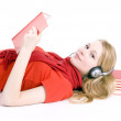 Girl in headphones lying — Stock Photo #1599635
