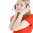 Young girl listening music — Stock Photo