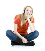 Girl listening music from mp3 player. — Stock Photo