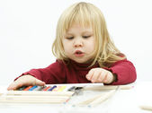Interested look at crayon young girl — Stock Photo