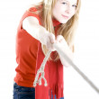 Young woman pulling rope - Stock Photo
