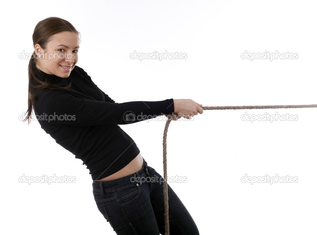 Smiling young, long hair, girl pulling grey rope, tug-of-war — Stock Photo #1624255