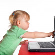 Little girl with laptop — Stock Photo #1704449