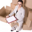 Businesswoman with clipboard and carton — Stock Photo