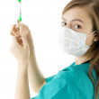 Nurse holding syringe — Stock Photo