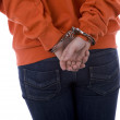 Standing backwards woman in handcuffs — Stockfoto