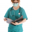 Woman doctor reading medical — Stock Photo