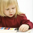 Interested look at crayon little girl — Stock Photo