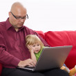 Stock Photo: Little girl with father on the computer